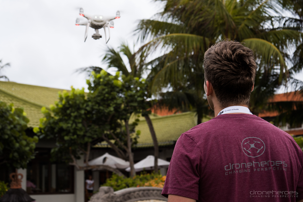 7 Tips to Take Your Travel Photography to a Higher Level from Drone Heroes 3 drone flying front of hotel