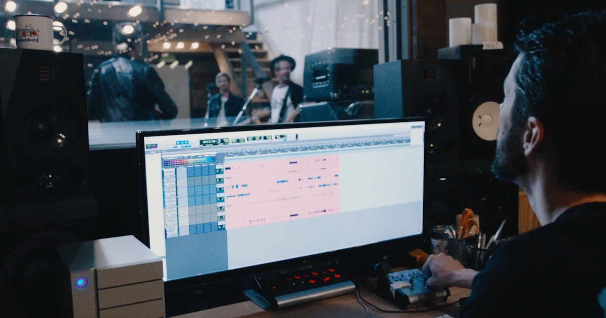 Switchfoot in studio and Tanner Sparks audio engineer at multi-track workstation